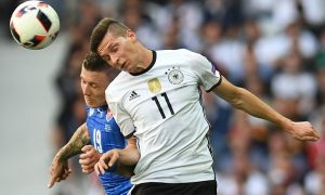 Slovakia's midfielder Juraj Kucka vies with Germany's midfielder Julian Draxler (R)during Euro 2016 round of 16 football match between Germany and Slovakia at the Pierre-Mauroy stadium in Villeneuve-d'Ascq, near Lille, on June 26, 2016.   / AFP / PATRIK STOLLARZ        (Photo credit should read PATRIK STOLLARZ/AFP/Getty Images)