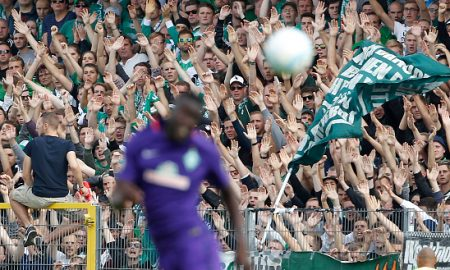 LOTTE, GERMANY - AUGUST 21:  Fans of Bremen cheer their players during the DFB Cup match between Sportfreunde Lotte and SV Werder Bremen at the Frimo Stadion on August 21, 2016 in Lotte, Germany. (Photo by Mika Volkmann/Bongarts/Getty Images)