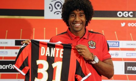 """Nice's defender Brazilian Dante poses with a new jersey after a press conference on August 24, 2016 at the """"Allianz Riviera"""" stadium in Nice, southeastern France.   Brazilian centre-back Dante joins Nice in Ligue 1 after completing his move from Wolfsburg. / AFP / VALERY HACHE        (Photo credit should read VALERY HACHE/AFP/Getty Images)"""